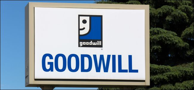 A Goodwill sign in front of some trees.