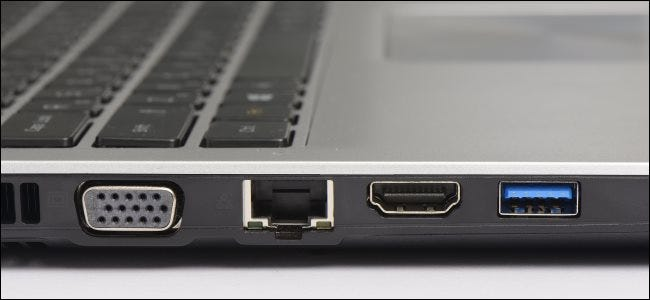 USB 3.0, Ethernet, and graphics ports on a laptop computer.